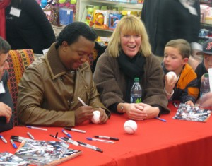 Pedro Martinez signings autographs at a toy drive